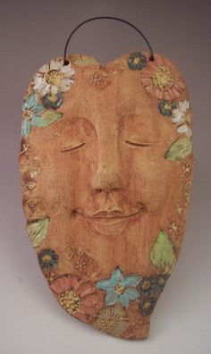 Spirit of the Garden Pottery Face Floral Smiling by ASmileBuiltIn