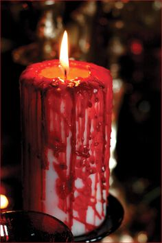 Vampire Style Halloween Candle - get a big white candle and a small red one, light the red one and drip all over the white one. Easy!