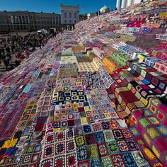 Stairs of the Helsinki Cathedral filled with crocheted patchwork quilts  - all hand-made in Finland for charity of Novita yarn <3