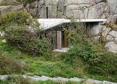 This seaside holiday home, (hytte) by Norwegian studio Lund Hagem nestles against a cliff, and features a stepped concrete roof that doubles as a viewing platform
