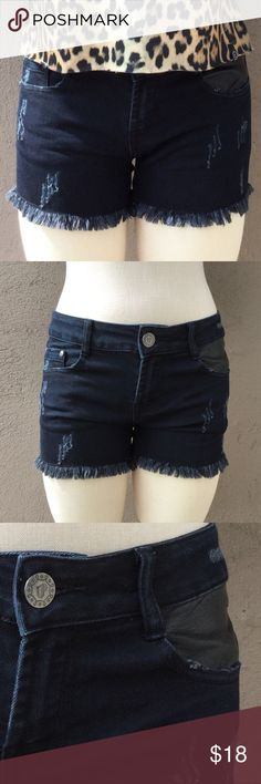 """Distressed Frayed Hem Jean Shorts! These black denim shorts feature five pocket construction with faux leather detail on one front and one back pocket, zip/button fly, distressed detailing and frayed hem. Measurements: 115"""" waist, 8"""" rise and 3"""" inseam. Has some stretch. Shorts Jean Shorts"""