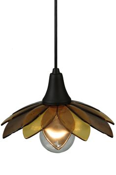 """10.5 Inch W Metro Fusion Bodnant Glass Mini Pendant - 10.5 Inch W Metro Fusion Bodnant Glass Mini Pendant Theme: ARTS & CRAFTS CONTEMPORARY Product Family: Metro Fusion Bodnant Product Type: CEILING FIXTURE Product Application: PENDANT Color: BRONZE/AMBER Bulb Type: MED Bulb Quantity: 1 Bulb Wattage: 60 Product Dimensions: 9""""-70H x 10.5WPackage Dimensions: NABoxed Weight: 2 lbsDim Weight: 30 lbsOversized Shipping Reference: NAIMPORTANT NOTE: Every Meyda Tiffany item is a unique handcrafted…"""