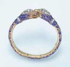 Best Diamond Bracelets : AN ANTIQUE ENAMEL AND DIAMOND BANGLE BRACELET Designed as twin old European-cut diamond and blue enamel griffin heads to the articulated blue enamel bracelet, enhanced by scrolled detail, mounted in gold, circa 7 ins Diamond Bracelets, Bangle Bracelets, Bangles, European Cut Diamonds, Quality Diamonds, Best Diamond, Diamond Cuts, Bracelet Designs, Antique Jewelry