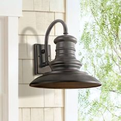Simple yet refined, this large bronze outdoor wall light is a versatile home accent. Vintage-look large outdoor wall light. Metal construction. Style # 2Y345 at Lamps Plus.