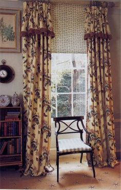 I like these window treatments with the attached valance & the shade below provides privacy.