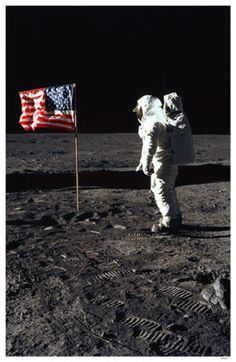 Man on the moon with American flag.