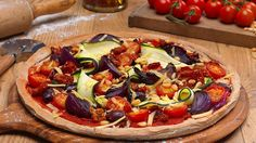 Whoever says cooking isn't fun has never tried tossing pizza dough. Give it a go with the kids with this simple and easy #dairyfree Roast Vegetable Pizza recipe. Covered in delicious vegetables, it's as good for you as it tastes!
