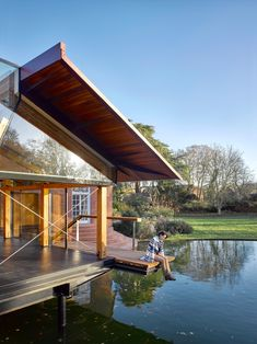 Architecture studio Hamish & Lyons has completed Stepping Stone House, an extension to a manor house in Berkshire, England, that is raised on stilts above a lake. Futuristic Architecture, Classical Architecture, Sustainable Architecture, Residential Architecture, Contemporary Architecture, Wooden Walkways, Small Buildings, House Extensions, Stone Houses
