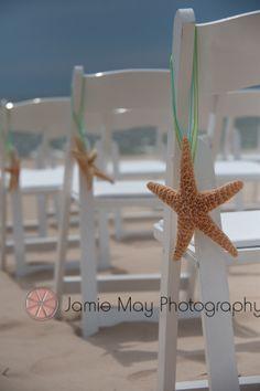 I love the idea of a beach wedding!  Starfish wedding ceremony decorations.