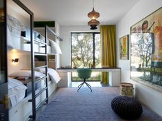A Modern Family Ranch in Texas Photo Steel railing on bunk bed, built in desk & bunk.