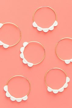 Learn how to create your own scalloped statement hoop earrings in minutes using a Silhouette Cameo or Portrait! Click through to watch video tutorial and download the cut files. by Sarah Hearts