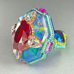 Titanium gold ruby opal sapphire and diamond ring by Wallace Chan. @wallacechanart #titaniumjewelry