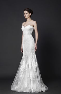 Off-White mermaid gown with sweetheart neckline and Tulle skirt, embellished with Lace embroideries.