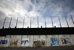 The Peace Line stands over 20ft (6m) high and was constructed to separate Catholic and Protestant communities in Belfast thereby 'keeping the peace'. What was meant as a temporary measure became more permanent as the barriers became longer and wider. The recent suggestion that they should be destroyed was met with anger from local residents and so its deconstruction remains a debated topic.
