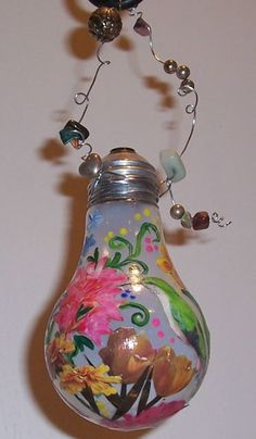 Images from old seed and plant catalogs decoupaged onto lightbulbs - click through for DIY! via Dave's Garden