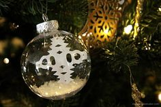 Make the Floating Snowflake Ball Ornament for your Christmas tree this season. This easy Christmas ornament craft will look gorgeous on every tree.