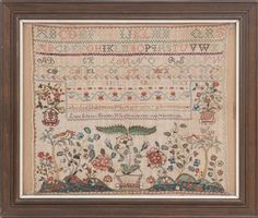 """FRAMED ANTIQUE AMERICAN NEEDLEWORK SAMPLER 19th Century <br /> """"Lydia Gilmans Sampler. Wrought in the thirteenth year of her age"""" with alphabets and numerals over an elaborately stitched and vividly colorful landscape design with flowers, trees, birds, etc. 19.25"""" x 21.25""""."""