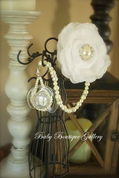 Baby Boutique White Flower with Ivory pearls 4-in-1 Beaded Pacifier Holder. $27.99, via Etsy.