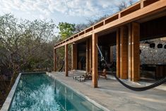Covered by a wooden roof clad in clay tiles, the living space opens out onto a long, sea-facing swimming pool. An adjacent stone roof terrace with clusters of local potted plants looks towards the same view. Farm Landscaping, Pergola, Natural Swimming Pools, Best Architects, Swimming Pool Designs, Bouldering, Concrete, Architecture, Outdoor Decor