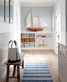 Cottage: striped runner mat and oversized model sail boat.