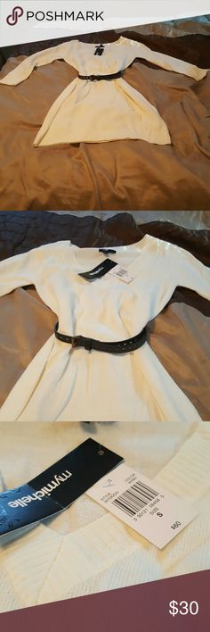 NWT white 3/4 sleeve sweater dress. New with tags white 3/4 sleeve sweater dress. Cute black belt includes. 100% Acrylic. My Michelle Dresses Midi
