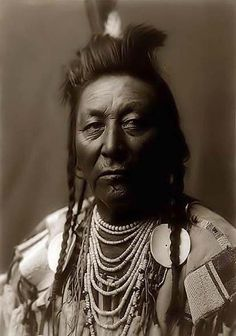 Picture of Plenty Coups, an Apsaroke Crow Indian Brave.  It was created in 1908 by Edward S. Curtis.