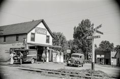 """Shorpy Historic Picture Archive :: Alt-Atlanta: 1938 high-resolution photo-May 1938. """"General store and railroad crossing, Atlanta, Ohio."""" Which way to the ATM? 35mm nitrate negative by Arthur Rothstein."""