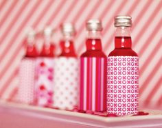 I love these little red drinks with pink labels. Would be perfect for your pink and red soiree.