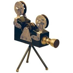 A very steam-punk-esque old fashioned movie film camera with all the nuts and bolts showing!