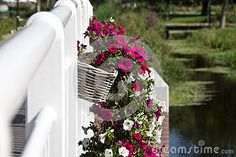 Flower baskets hanging on the railing of a bridge