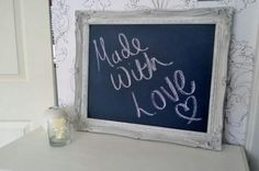 Vintage framed chalk board....I can think of many uses...thanks Jinger for the idea