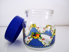 Vintage glass storage jar/ colorful fruit decal glass jar / apples cherries plums grapes on blue lattice/ ACL painted/ kitchen canister. $12.00, via Etsy.