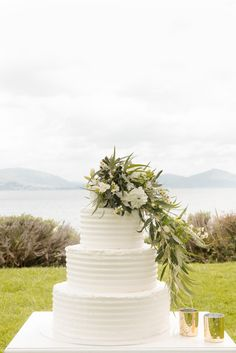 The wedding cake is traditionally what you will firstly share with your new husband.  This needs to look beautiful, taste delicious and represent the Bride and Groom celebrating!  #weddingcake #simplicity #elegantcake #weddingingreece #cakewithflowers #moderncake