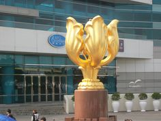 """""""Forever Blooming Bauhinia"""" sculpture in front of Hong Kong Convention Center in Golden Bauhinia Square given by Central Chinese Government in 1997 culminating transition of Hong Kong from the British to Chinese."""