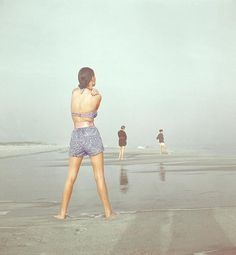 Back View Of Three People At A Beach Art Print by Serge Balkin. All prints are professionally printed, packaged, and shipped within 3 - 4 business days. Choose from multiple sizes and hundreds of frame and mat options.