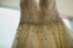 Bride wore a custom made dress by Sharon Bowen with applique daisies  | Photography by http://jesspetrie.com/