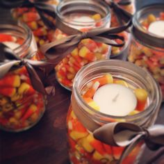 Candy corn filled mason jars with a tea light on top! Just added some ribbon for a finishing touch! Happy Fall!