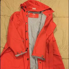 Helley Hensen Rain Coat ! It's a gorgeous rain coat , very good for the rain :) worn once before its in excellent condition !! It's like a reddish peach color Jackets & Coats