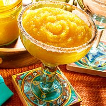 """For a tropical take on a classic Mexican cocktail, try this tangy Frozen Mango Margarita! Here, frozen GOYA Mango Pulp (100% Natural Mango Fruit Pulp) is mixed into a traditional Margarita mixture of tequila, lemon juice and orange liqueur. Blend up a batch at your next """"grownups only"""" fiesta and share this frozen treat with friends and family."""