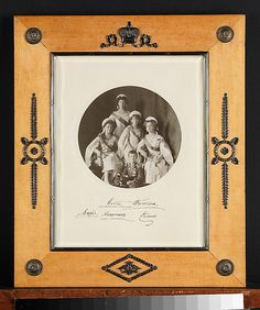 Picture frame with signed photograph, frame by Carl Fabergé, workmaster: Karl Gustav Hjalmar Armfelt, 1908–17, in birchwood with silver-gilt mounts; the photograph of Grand Duchess Olga Nikolaevna, Grand Duchess Tatiana Nikolaevna, Grand Duchess Maria Nikolaevna, Grand Duchess Anastasia Nikolaevna and Tsarevich Alexei Nokolaevich of Russia, photo signed by the above
