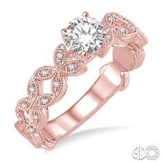 PINK GOLD = GORGEOUS  needs a princess cut center tho  Diamond Engagement Ring with Round Cut Center Stone in 14K Pink Gold