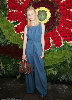 Denim darling! Elle Fanning makes a fashion statement in jean jumpsuit | Daily Mail Online