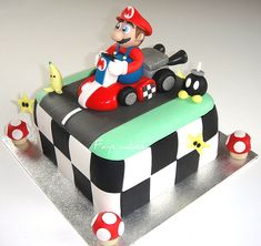 Inspiration for 10 year old's Birthday cake.   Changed black to a royal blue and used Knex Mario Kart as topper
