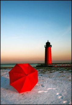 lighthouse & red umbrella - no lady in red?