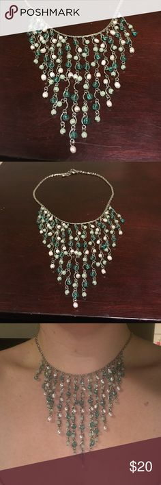Beautiful dangling necklace In perfect condition. Love this necklace, just not much opportunity to wear it. Jewelry Necklaces