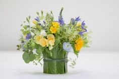 yellow and blue arrangement in organic container Françoise Weeks