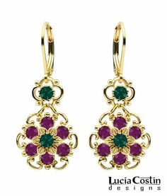European Chic Flower Dangle Earrings by Lucia Costin Made of .925 Sterling Silver Plated with 14K Yellow Gold with Amethyst and Dark Green Swarovski Crystals and Dots; Handmade in USA Lucia Costin. $54.00. Unique jewelry handmade in USA. Irresistible Dangle earrings by Lucia Costin. Flowers and fancy ornaments beautifully combined. Enhanced with purple and emerald green Swarovski crystals. Update your everyday style with inspiration when wearing this piece of jewelry