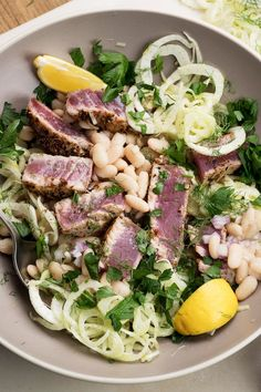Red Onion; Cannellini (or White) Bean; Lemon, Garlic, and Chili Flake Dressed Fennel; and Fennel Seed and Pollen Crusted Tuna Fillet Salad with Parsley and Fennel Fronds