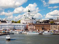 Helsinki ... we walked along beautiful, stately buildings to reach the harbor ... and were greeted with an art festival, flowers, food booths.  Great fish lunch!