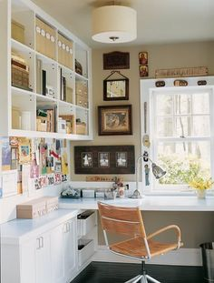 organize office | Getting Organized. | feels like home - I like the baskets up underneath for less frequently used things, but still uses that space.